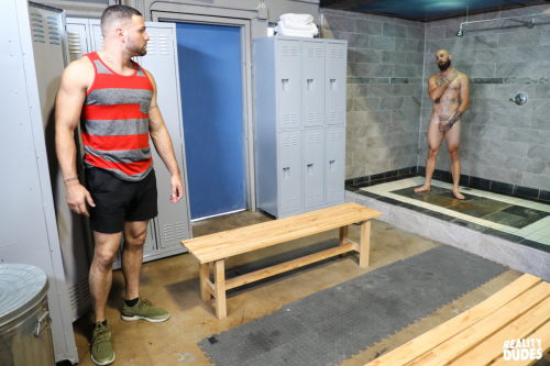 Horny sportsmen eyes meet across the locker room